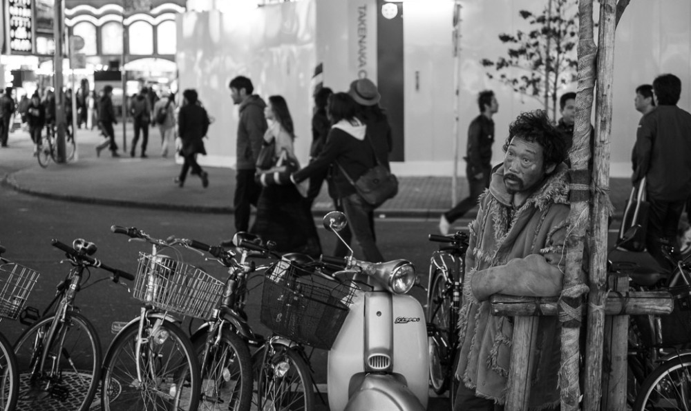 Homeless man with bikes